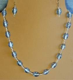 Light blue silver lined glass beads necklace and/or matching earrings